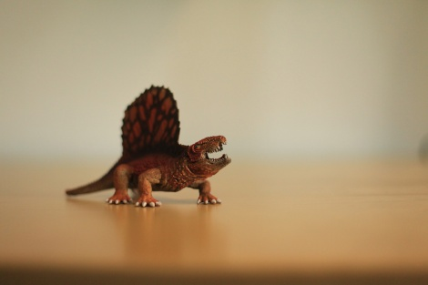 dinosaur figure in children´s book author John Brito`s workspace